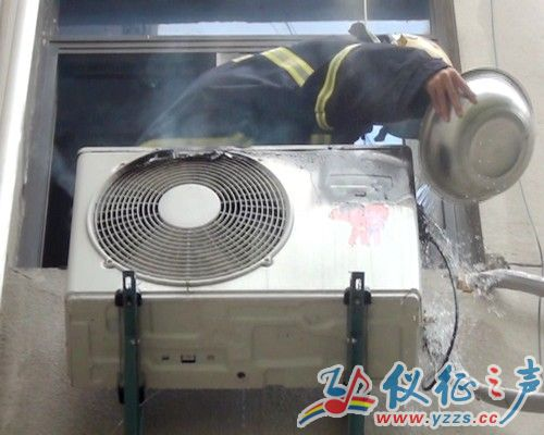 仪征一小区某品牌空调主机失火